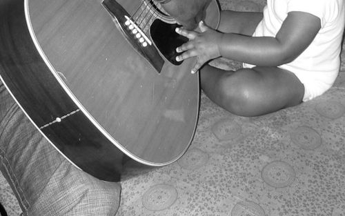 father and son play guitar