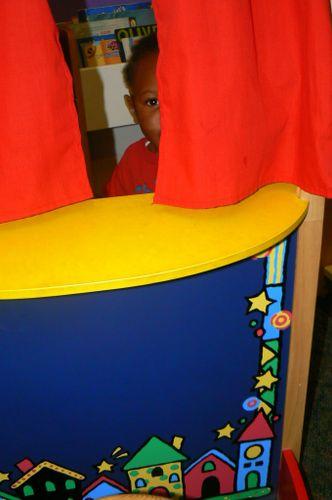 Boy peeking around curtain