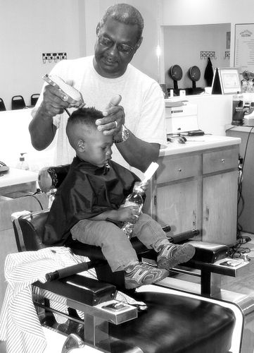 boy getting first haircut
