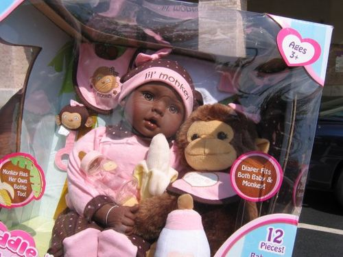 black baby doll and a monkey